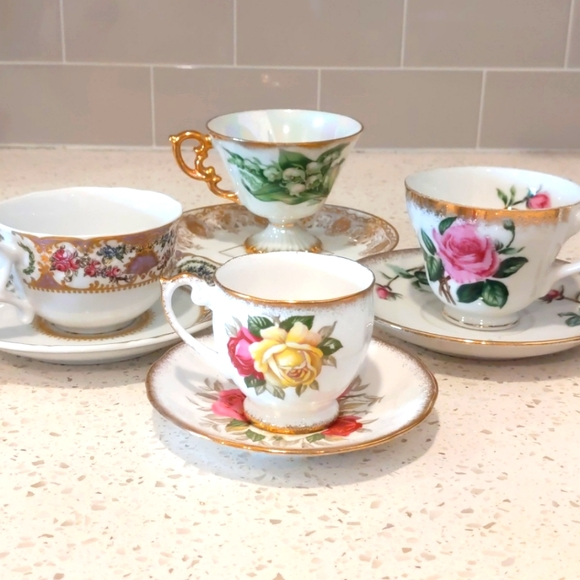 Assortment of 4 Floral Teacups & Saucers with Gold Trim
